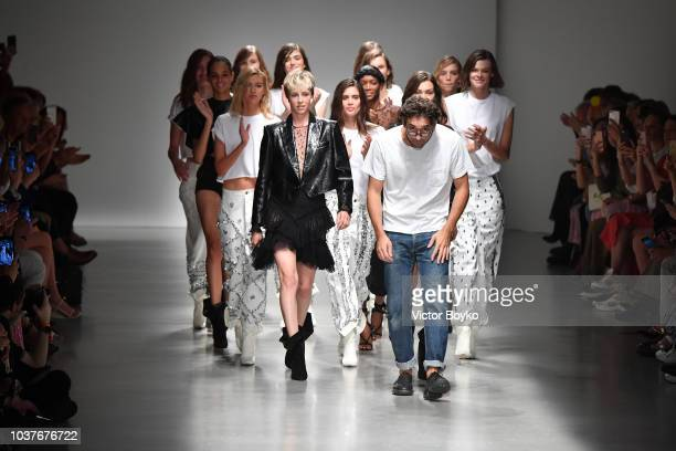 Designer Lorenzo Serafini Bella Hadid and models acknowledge the applause of the audience at the Philosophy Di Lorenzo Serafini show during Milan...