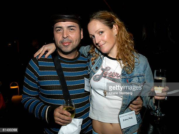 Designer Louis Verdad and designer Ashley Paige pose at the Mercedes Benz Fashion Week Cocktail Party at the St Regis Hotel on October 5 2004 in Los...