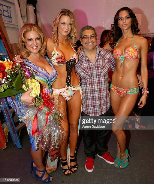 Designer Lourdes Hanimian and Augusto Hanimian poses with models backstage at the Luli Fama show during MercedesBenz Fashion Week Swim 2014 at Cabana...