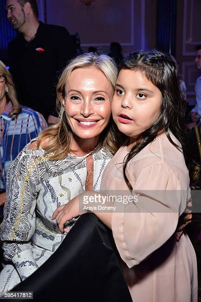 Designer Lubov Azria and a MakeAWish recipient attend the Inaugural Fashion Show Benefiting MakeAWish with BCBGMAXAZRIA and Celebrity Host Brad...