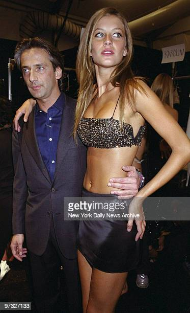 Designer Luca Orlandi and model Gisele get together backstage at his fall 2000 show at NYC Fashion Week in Bryant Park