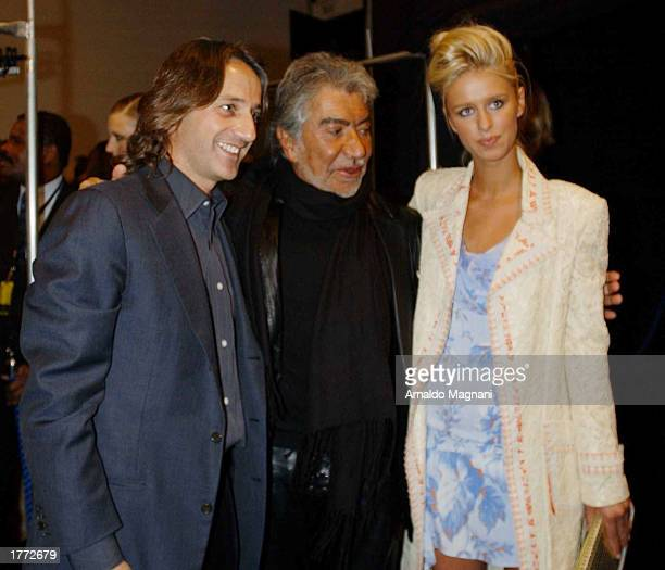 Designer Luca Orlandi Roberto Cavalli and Nicky Hilton attend the Luca Luca fall fashion show February 9 2003 during MercedesBenz Fashion Week in New...