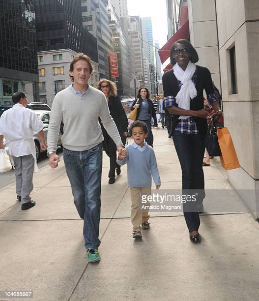 Designer Luca Orlandi son Ugo and wife Oluchi Onweagba walking on Madison Avenue on October 03 2010 in New York City