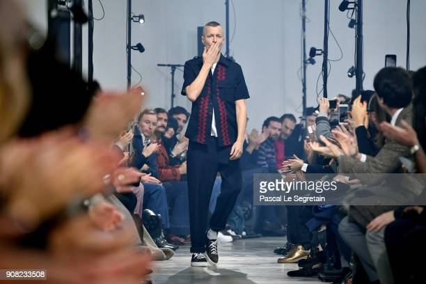 Designer Lucas Ossendrijver acknowledges applause on the runway during the Lanvin Menswear Fall/Winter 20182019 show as part of Paris Fashion Week on...
