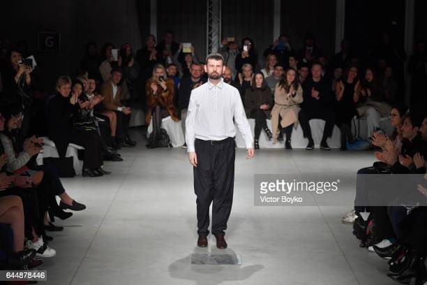 Designer Lucio Vanotti walks the runway after his show during Milan Fashion Week Fall/Winter 2017/18 on February 24 2017 in Milan Italy