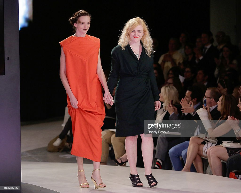 Designer Lucy Trower with a model wearing one of her designs walks the runway at the 114th Annual Pratt Institute Fashion Show at Center 548 on April 25, 2013 in New York City.