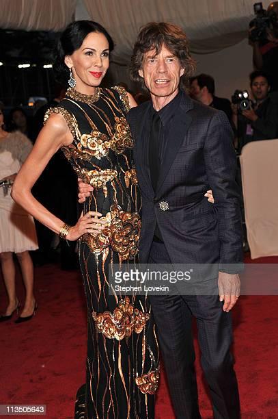 "Designer L'Wren Scott and musician Mick Jagger attend the ""Alexander McQueen: Savage Beauty"" Costume Institute Gala at The Metropolitan Museum of Art..."