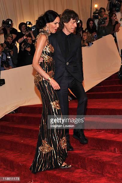 Designer L'Wren Scott and musician Mick Jagger attend the 'Alexander McQueen Savage Beauty' Costume Institute Gala at The Metropolitan Museum of Art...