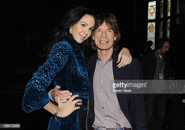 Designer L'Wren Scott and musician Mick Jagger pose at the L'Wren Scott Fall 2012 fashion show during MercedesBenz Fashion Week at the Desmond Tutu...