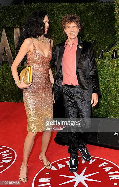 Designer L'Wren Scott and singer Mick Jagger arrive at the Vanity Fair Oscar Party at Sunset Tower on February 27 2011 in West Hollywood California