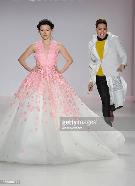 Designer Ly Qui Khanh and a model walk the runway in a design by Ly Qui Khanh at the New York Life fashion show during Mercedes-Benz Fashion Week...
