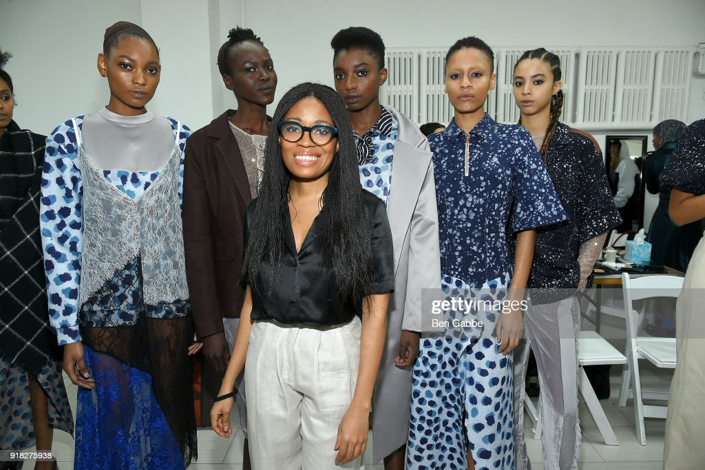 Designer Maki Oh (C) poses with models backstage at the Maki Oh fashion show during New York Fashion Week on February 14, 2018 in New York City.