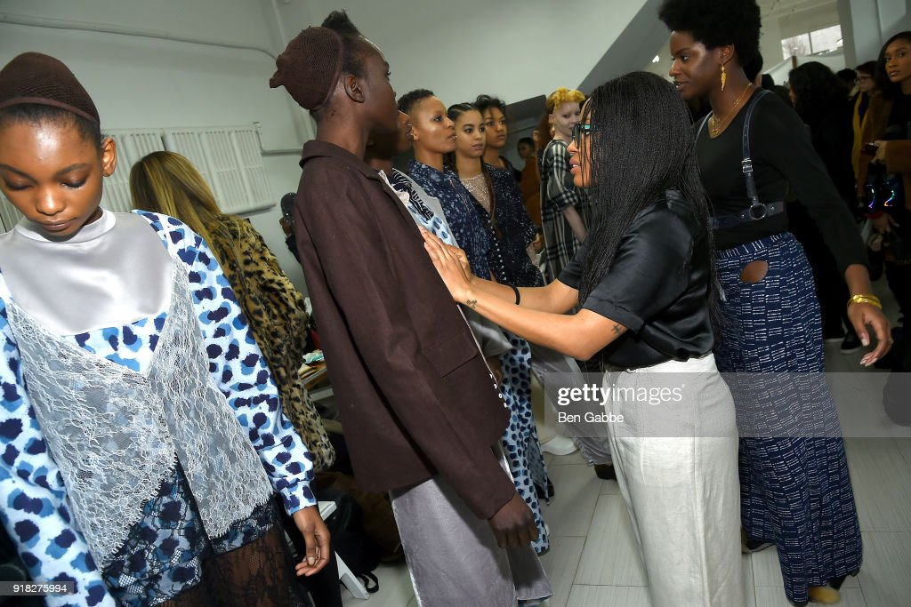 Designer Maki Oh (R) prepares models backstage at the Maki Oh fashion show during New York Fashion Week on February 14, 2018 in New York City.