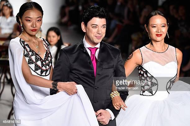 Designer Malan Breton appears on the runway at the Malan Breton fashion show during MercedesBenz Fashion Week Spring 2015 at Lincoln Center on...