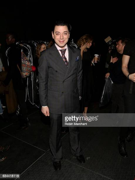 Designer Malan Breton poses backstage at his show during New York Fashion Week at The Theater at Madison Square Garden on February 9 2017 in New York...