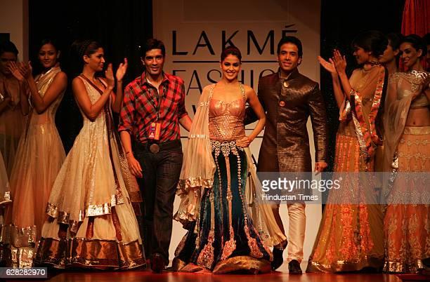 Designer Manish Malhotra Bollywood Actor Tushar Kapoor and Actress Genelia D'souza walks on the ramp in a Manish Malhotra creation at Lakme Fashion...