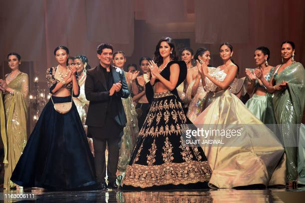 Designer Manish Malhotra greets the audience after presenting his creations at Lakme Fashion Week Winter Festive 2019 as Bollywood actress Katrina...
