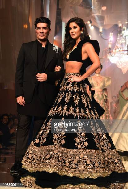 Designer Manish Malhotra is accompanied by Bollywood actress Katrina Kaif as he greets the audience after presenting his creations at Lakme Fashion...