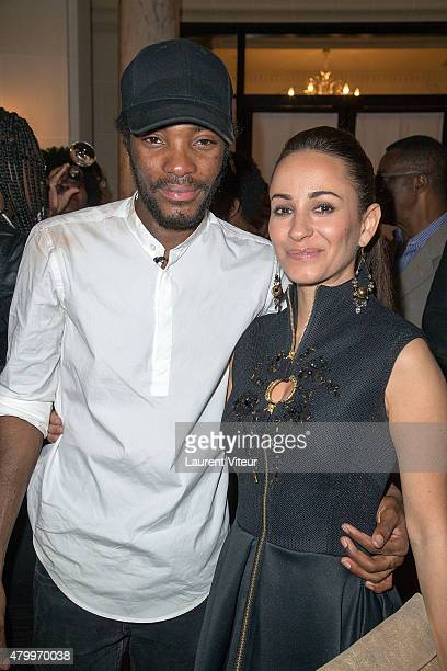 Designer Manu Reas and Sanaa Alaoui attend the Manu Reas show as part of Paris Fashion Week Haute Couture Fall/Winter 2015/2016 on July 8 2015 in...