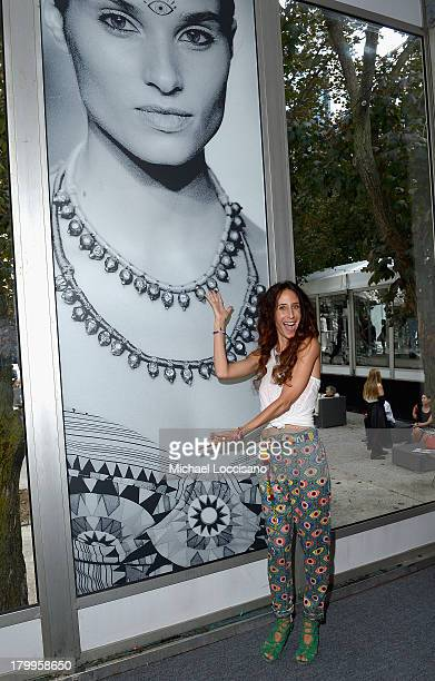 Designer Mara Hoffman stands in front of a photo from her MercedesBenz Fashion Week Swim 2014 fashion show during MercedesBenz Fashion Week Spring...