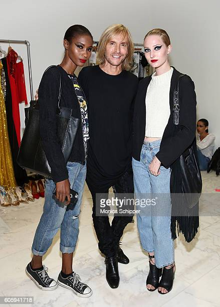 Designer Marc Bouwer poses for a photo with models backstage at the Marc Bouwer fashion show during New York Fashion Week September 2016 on September...