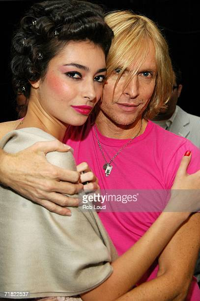 Designer Marc Bouwer poses with a model backstage at Marc Bouwer Spring 2007 fashion show during Olympus Fashion Week at the Atelier tent in Bryant...