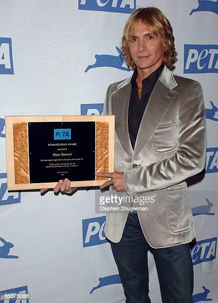 Designer Marc Bouwer poses with his Humanitarian Award backstage at PETA?s 15th Anniversary Gala and Humanitarian Awards at Paramount Studios on...