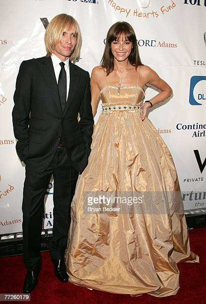 Designer Marc Bouwer poses with model Carolina Parsons at the Heart Of Gold Ball to benefit The Happy Hearts Fund at Cipriani's Wall street location...