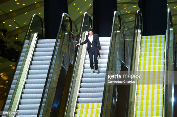 Designer Marc Jacobs acknowledges the applause of the audience after the Louis Vuitton Spring/Summer 2013 show as part of Paris Fashion Week on...