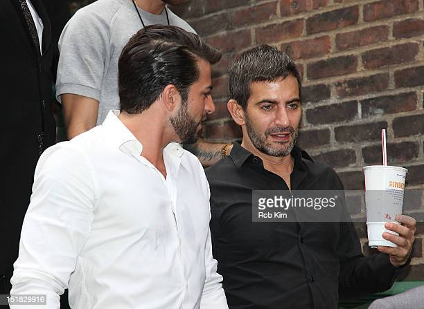 Designer Marc Jacobs and boyfriend Harry Louis arrive for the Marc for Marc Jacobs show on September 11 2012 in New York City