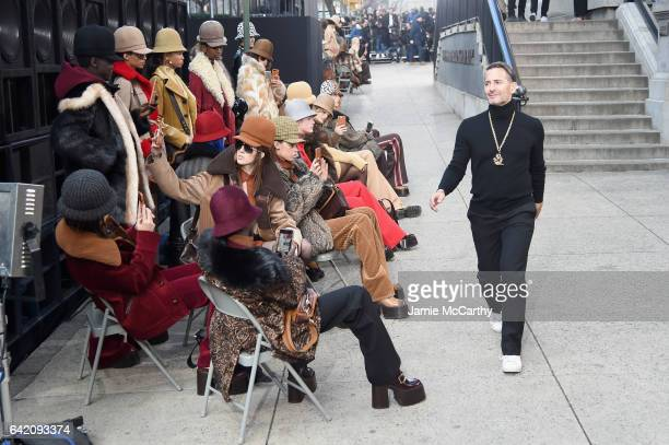 Designer Marc Jacobs greet his models on the outside runway at the Marc Jacobs Fall 2017 Show at Park Avenue Armory on February 16, 2017 in New York...
