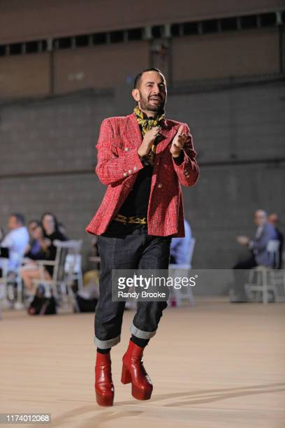 Designer Marc Jacobs greets everyone from the runway after his Marc Jacobs Spring 2020 Runway Show at Park Avenue Armory on September 11, 2019 in New...