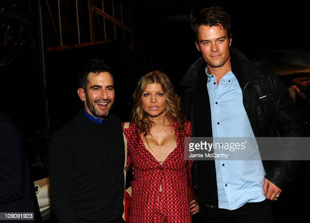 Designer Marc Jacobs, singer Fergie and actor Josh Duhamel pose backstage at the Marc Jacobs Fall 2011 Collection at N.Y. State Armory on February...