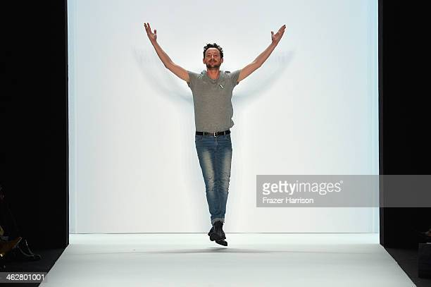 Designer Marcel Ostertag acknowledges the audience after the Marcel Ostertag show during MercedesBenz Fashion Week Autumn/Winter 2014/15 at...