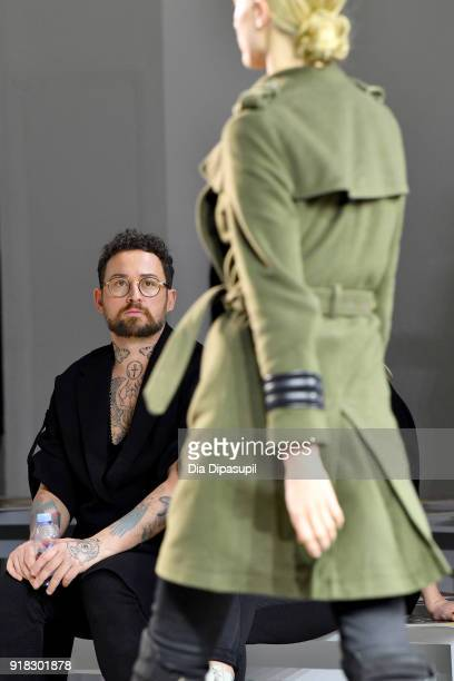 Designer Marcel Ostertag and a model prepare backstage for Marcel Ostertag front row during New York Fashion Week The Shows at Gallery II at Spring...