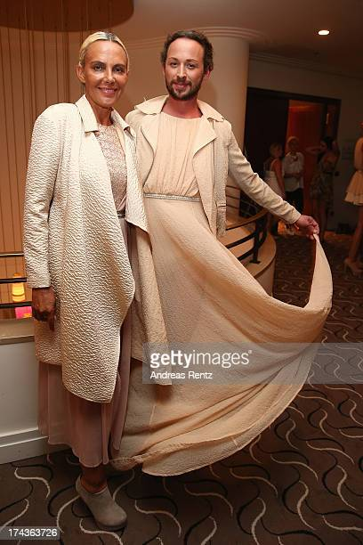 Designer Marcel Ostertag and model Natascha Ochsenknecht prepare backstage prior to the Marcel Ostertag fashion show at Charles Hotel on July 24 2013...