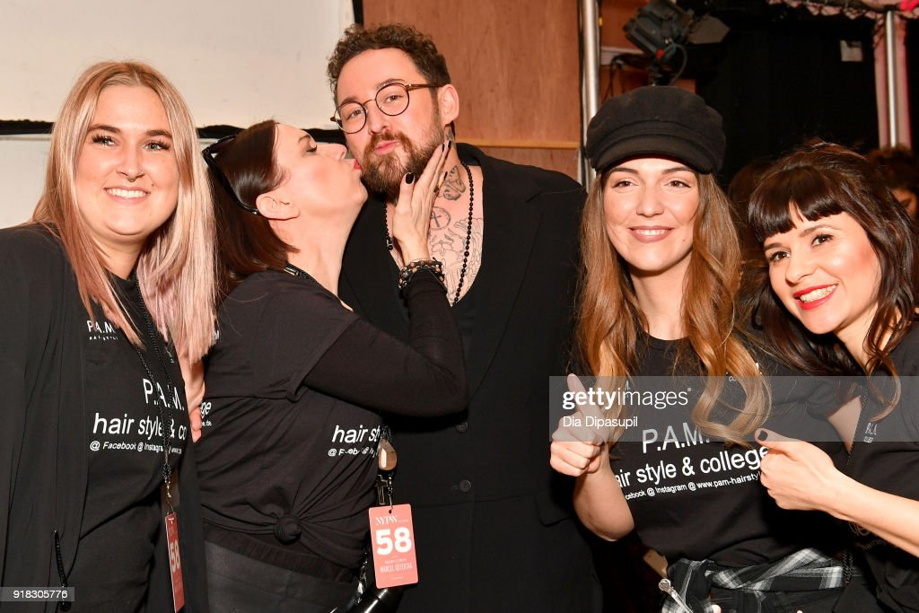 Designer Marcel Ostertag (C) and stylists pose backstage for Marcel Ostertag during New York Fashion Week: The Shows at Gallery II at Spring Studios on February 14, 2018 in New York City.