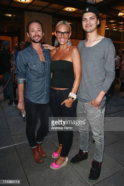 Designer Marcel Ostertag Natascha Ochsenknecht and her son Jimi Blue Ochsenknecht attend the Marcel Ostertag fashion show at Charles Hotel on July 24...