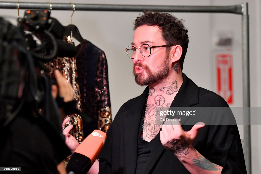 Designer Marcel Ostertag prepares backstage for Marcel Ostertag during New York Fashion Week: The Shows at Gallery II at Spring Studios on February 14, 2018 in New York City.