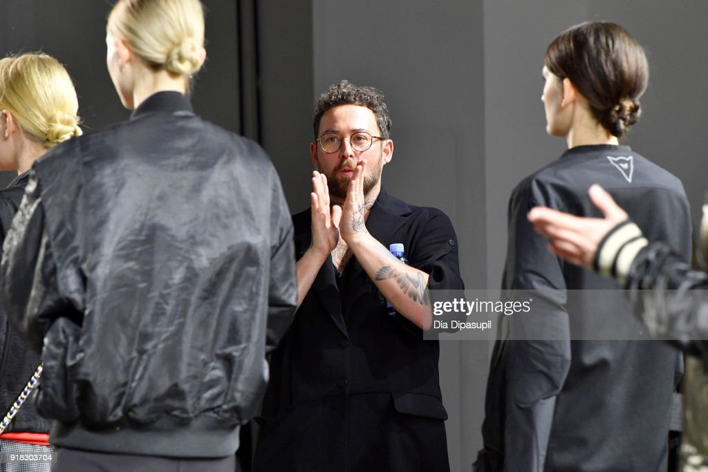 Designer Marcel Ostertag (C) prepares the models backstage during Marcel Ostertag front row during New York Fashion Week: The Shows at Gallery II at Spring Studios on February 14, 2018 in New York City.