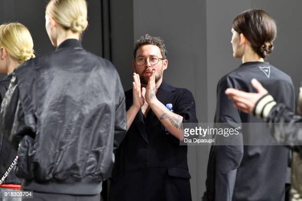 Designer Marcel Ostertag prepares the models backstage during Marcel Ostertag front row during New York Fashion Week The Shows at Gallery II at...