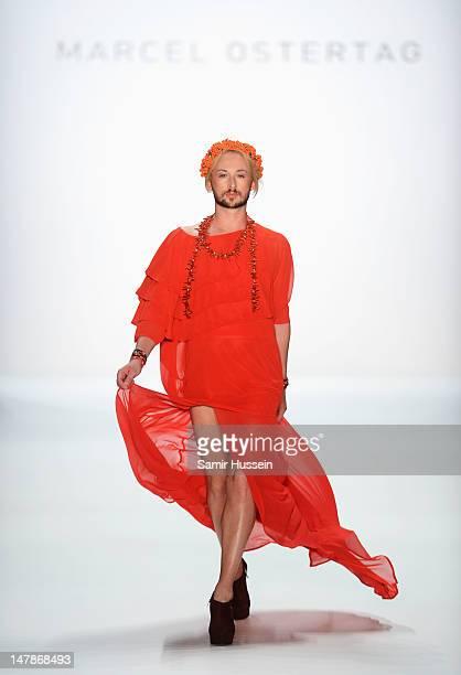 Designer Marcel Ostertag walks the catwalk during the Marcel Ostertag show at the MercedesBenz Fashion Week Spring/Summer 2013 on July 5 2012 in...