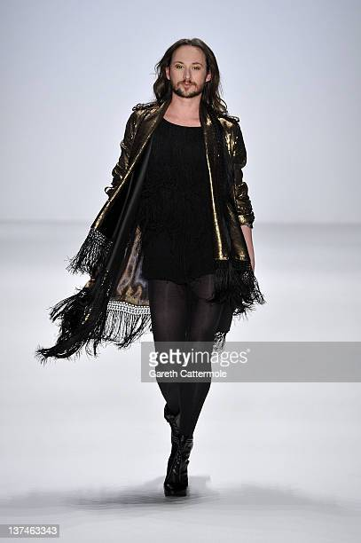 Designer Marcel Ostertag walks the runway at the Marcel Ostertag Autumn/Winter 2012 fashion show during MercedesBenz Fashion Week Berlin at...