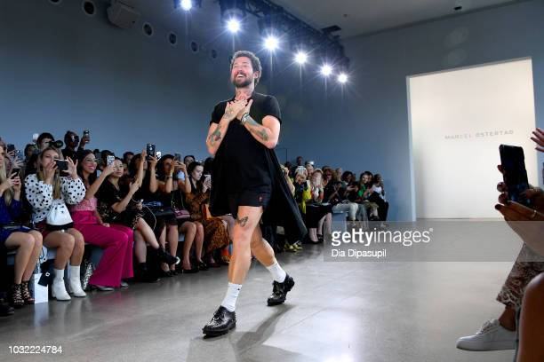 Designer Marcel Ostertag walks the runway at the Marcel Ostertag front Row during New York Fashion Week The Shows at Gallery II at Spring Studios on...