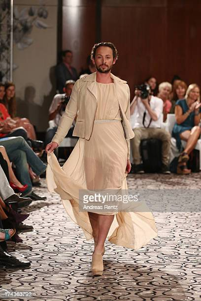 Designer Marcel Ostertag walks the runway during the Marcel Ostertag fashion show at Charles Hotel on July 24 2013 in Munich Germany