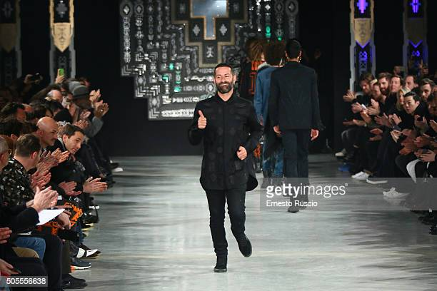 Designer Marcelo Burlon acknowledges the applause of the public after the Marcelo Burlon County Of Milan show during Milan Men's Fashion Week...