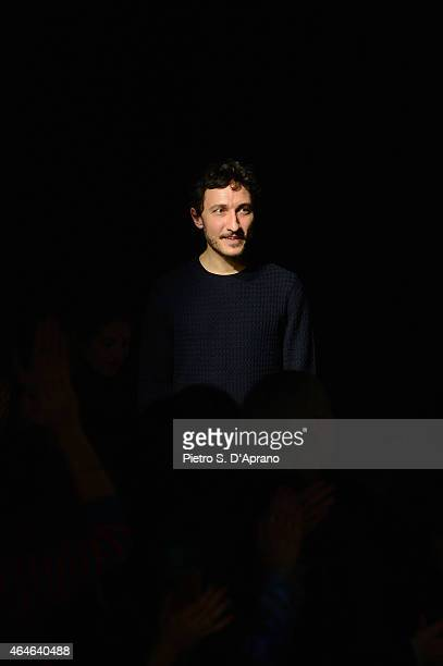 Designer Marco De Vincenzo acknowledges the audience following the Marco De Vincenzo show during the Milan Fashion Week Autumn/Winter 2015 on...