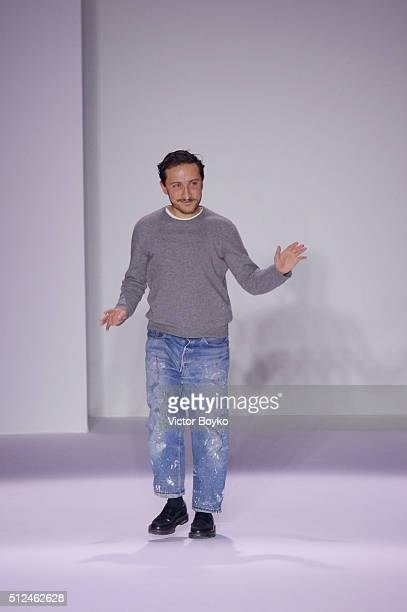 Designer Marco De Vincenzo ackowledges the applause of the audience at the end of the Marco De Vincenzo show during Milan Fashion Week Fall/Winter...