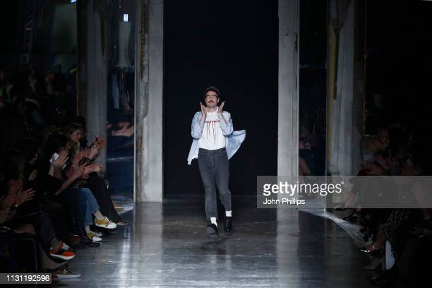 Designer Marco Rambaldi acknowledges the applause of the audience at the Marco Rambaldi Supported By CNMI e CNMI Fashion Trust show at Milan Fashion...