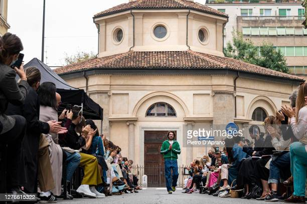 Designer Marco Rambaldi ackowledges the applause of the audience at the Marco Rambaldi fashion show during the Milan Women's Fashion Week on...
